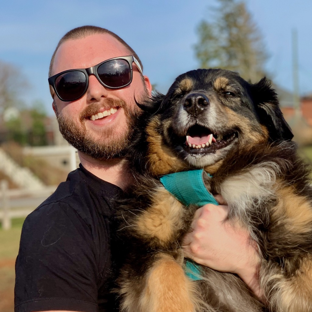 Kurtis with his dog Guinness (Australian Shepherd)